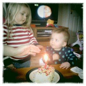 H and M with birthday cake